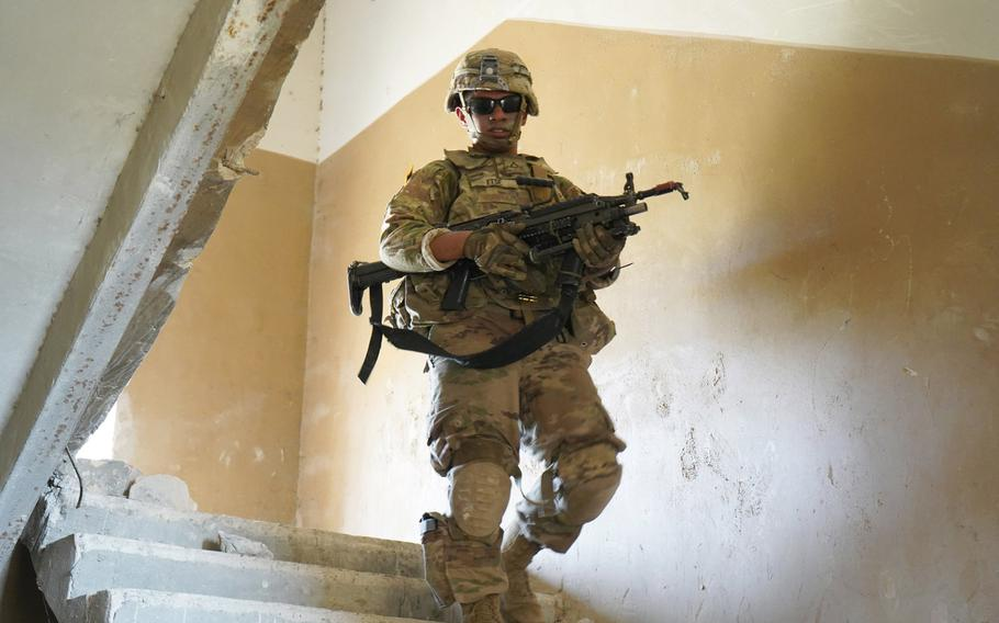A U.S. soldier of 2nd Squadron, 2nd Cavalry Regiment, makes his way down the stairs at the conclusion of the squadron?s room breaching and clearing exercise during Agile Spirit 19 near Tbilisi, Georgia, July 29, 2019.