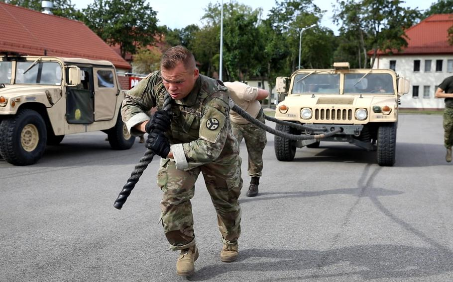 A U.S. soldier helps his team pull a Humvee during the Interoperability Games in Bemowo Piskie, Poland, Saturday, August 3, 2019.