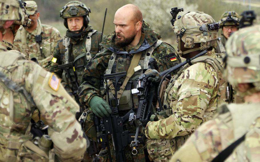 Soldiers of the 92nd Military Police Company strategize with their German counterparts at the Hohenfels Training Area in southeastern Germany. Chancellor Angela Merkel has said the country must strive to improve its military.