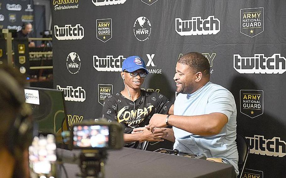 Gamer JSH3LLZ, right, congratulates Bloodngutz7 on winning the Street Fighter V tournament at Vilseck, Germany, Saturday, Aug. 17, 2019.