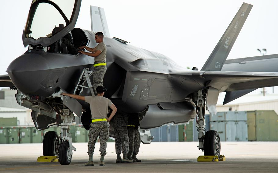 Crew chiefs with the 421st Aircraft Maintenance Unit work on an F-35A Lightning II returning to Hill Air Force Base, Utah, July 31, 2019, after a two-month European deployment.