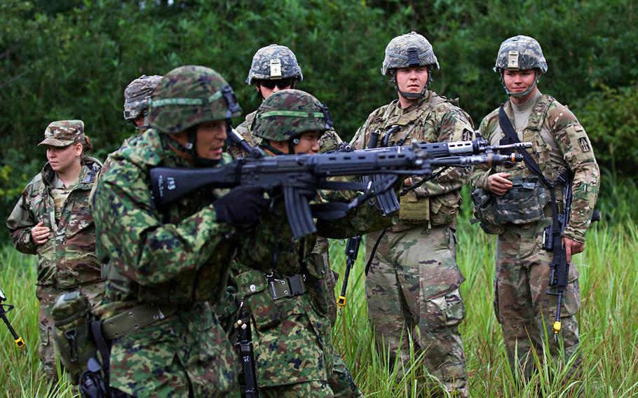 Soldiers with the Indiana National Guard's 76th Infantry Brigade Combat Team watch a care-under-fire demonstration by members of the Japan Ground Self-Defense Force during Orient Shield 2018 in Miyagi prefecture, Japan.