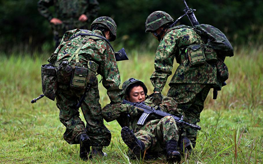 Soldiers with the Japan Ground Self-Defense Force perform a care-under-fire demonstration during Orient Shield 2018 in Miyagi prefecture, Japan.