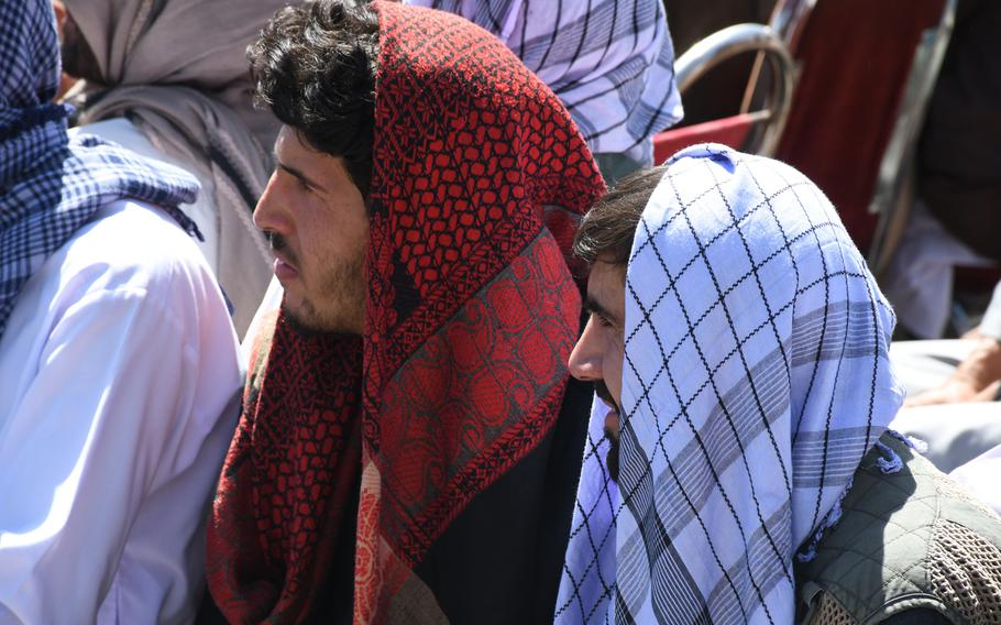 Two supporters listen to Ahmad Massoud, son of slain Northern Alliance leader Ahmad Shah Massoud, as he launches a new anti-Taliban movement in Panjshir, Afghanistan, on Thursday, Sept. 5, 2019.