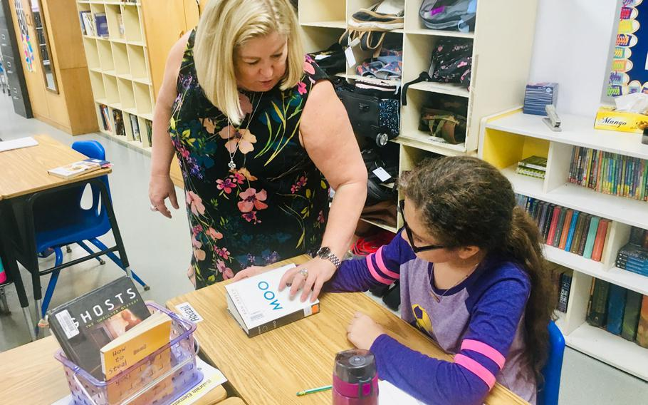 Heather Heffernan, a 5th grade teacher at the Bahrain School, goes over classwork with a student on Sept. 5, 2019. The Bahrain School has a new policy of assigning no homework other than reading for grades K-5, falling in line with a Bahrain Ministry of Education decision announced last year.