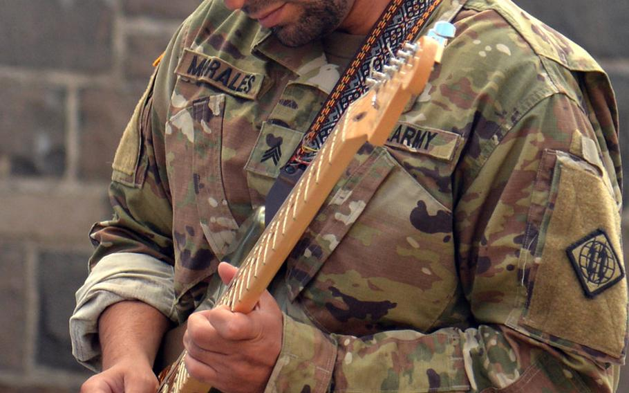 Sgt. Herman Morales of the 44th Expeditionary Support Battalion out of Baumholder, Germany, plays the Star-Spangled Banner at the grand opening of the USO center on Smith Barracks in Baumholder, Sept. 9, 2019.