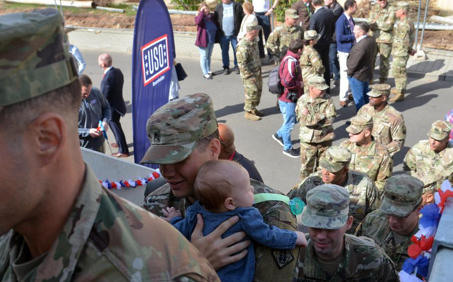 Servicemembers, civilians and families climb the stairs to the new Baumholder, Germany, USO center on Smith Barracks, moments after the ribbon-cutting. More than 300 people came out for the opening Sept. 9, 2019.