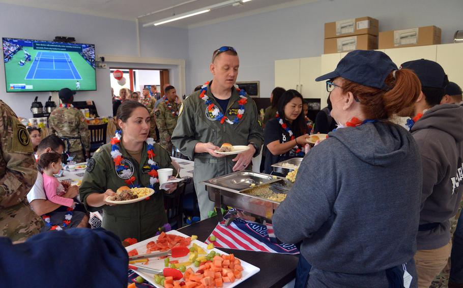 USO volunteers dish out the food at the grand opening of the new USO center on Smith Barracks in Baumholder, Germany, Sept. 9, 2019.