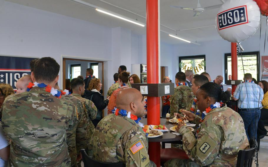 People enjoy the food at the grand opening of the new USO center in Baumholder, Germany, Sept. 9, 2019.