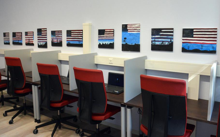 A row of laptops sit in the computer room of the new Baumholder USO center on Smith Barracks, letting servicemembers connect to loved ones worldwide. The art is courtesy of the base health clinic.