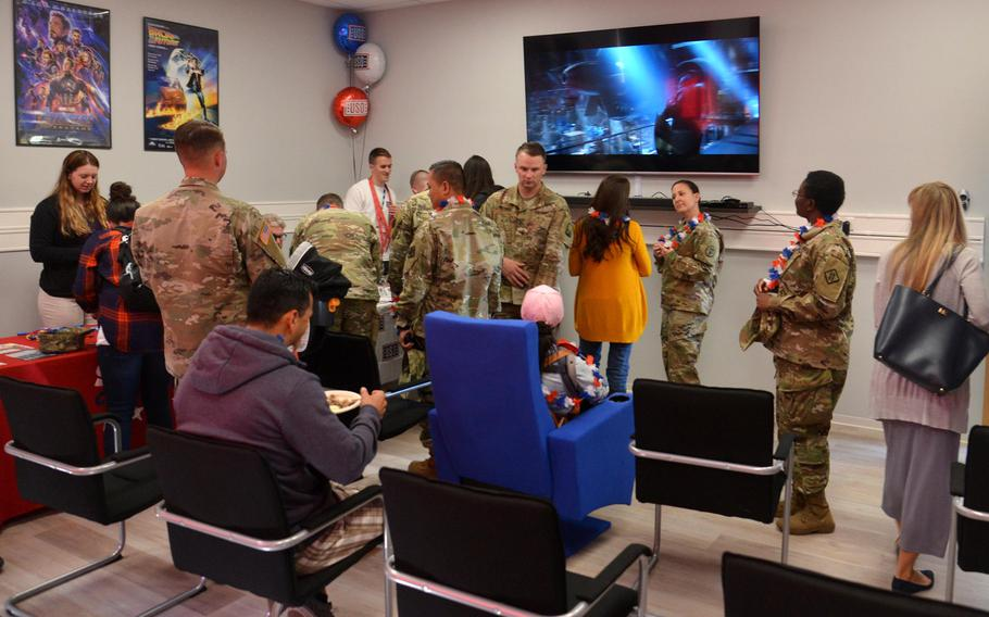 Visitors check out the movie room at new USO center on Smith Barracks in Baumholder, Germany, after its grand opening, Sept. 9, 2019.