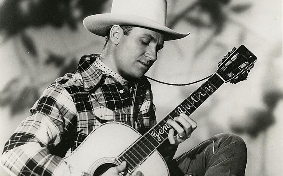 """Gene Autry, nicknamed The Singing Cowboy, enlisted in the Army Air Corps during a live broadcast of his Western variety show """"Melody Ranch"""" in 1942 and went on to pilot a C-109 cargo plane on a dangerous operation over the Himalayas. He later shared wartime experiences through his music, including the song """"At Mail Call Today,"""" describing a young soldier learning that the girl he loved back home had left him."""