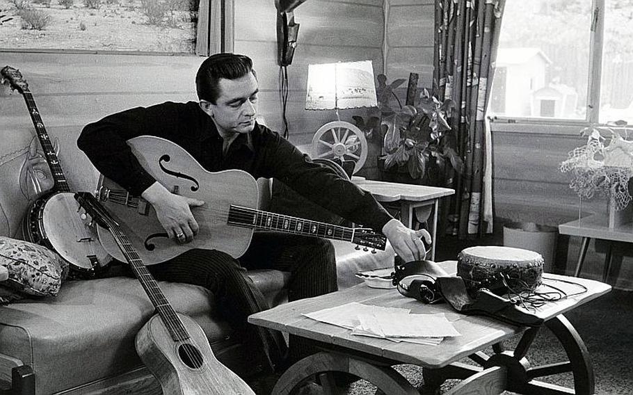Johnny Cash at his home in California in 1960. Cash spent four years in the Air Force before being honorably discharged as a staff sergeant. Eventually, Cash would give Kris Kristofferson, another veteran turned country musician, his big break by recording one of Kristofferson's songs.