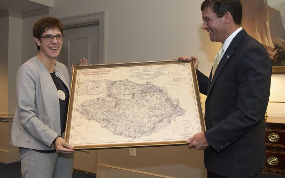 German Defense Minister Annegret Kramp-Karrenbauer presents U.S. Defense Secretery Mark T. Esper with a historical map of the Grafenwoehr training area during her visit to the Pentagon, Sept. 23, 2019. Esper, a former soldier once stationed in Vicenza, Italy with the 173rd Airborne Brigade, frequently trained at U.S. Army ranges in Hohenfels and Grafenwoehr, Germany.