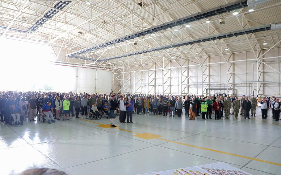 Participants and volunteers stand during the singing of the U.S. national anthem at the beginning of the 38th Annual Joan Mann Sports Day, Sept. 27, 2019, at RAF Mildenhall.