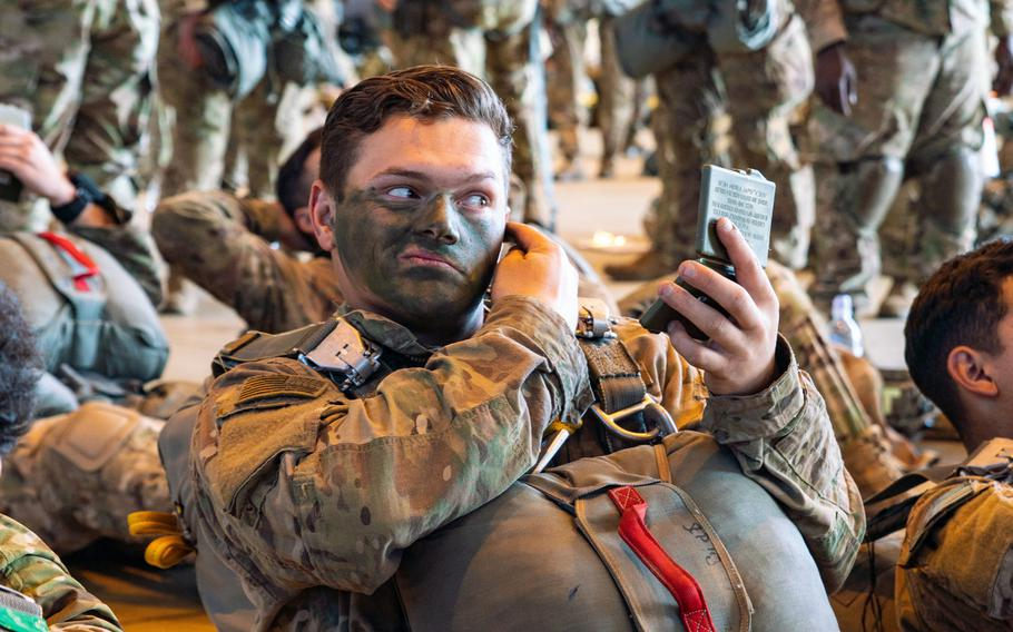 A U.S. Army paratrooper with the 173rd Airborne Brigade applies camouflage face paint prior to a mission during Saber Junction 19, at Ramstein Air Base, Germany, Sep. 18, 2019.