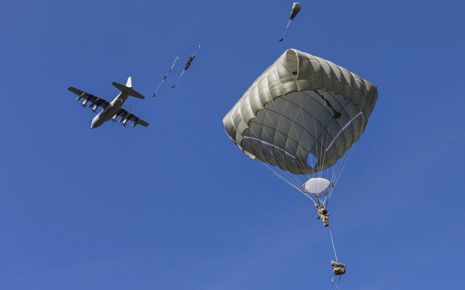A U.S. Army paratrooper from the 173rd Airborne Brigade jumps from a U.S. Air Force C-130 transport aircraft, during joint forcible entry training for Saber Junction 2019, at the Hohenfels Training Area, Sept. 18, 2019.