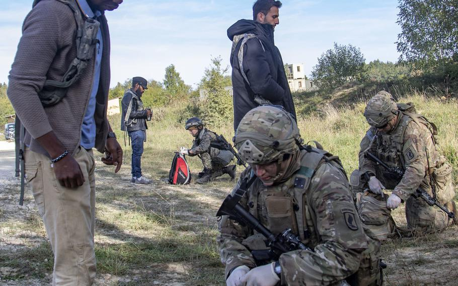 American and Bosnian soldiers conduct bag searches during a simulated non-combatant evacuation operation as part of Saber Junction 19 at the U.S. Army's Joint Multinational Readiness Center in Hohenfels, Germany, Sept. 20, 2019.