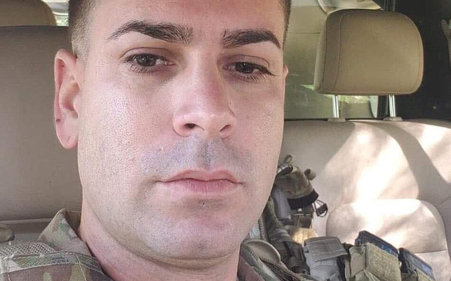 Sgt. 1st Class Elis A. Barreto Ortiz, 34, from Morovis, Puerto Rico, poses for a selfie from the cab of his unarmored pick-up truck while on a convoy through Kabul, Afghanistan.  Barreto, who was promoted posthumously, died Sept. 5 when a Taliban suicide bomb tore through his convoy.