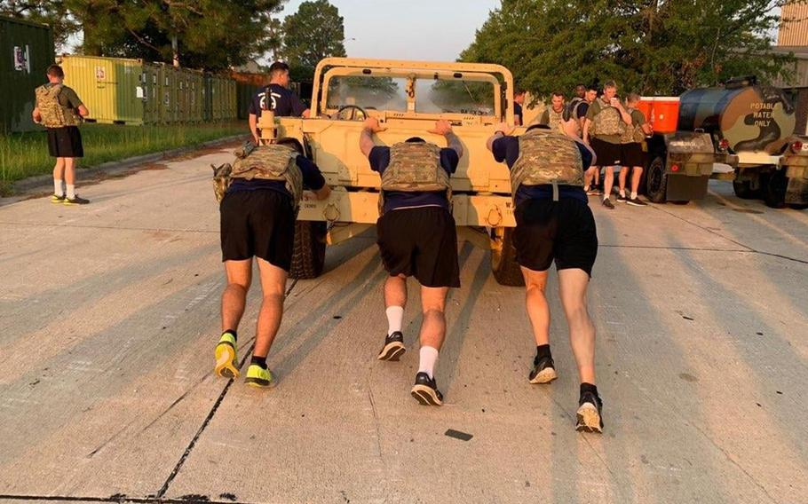 Staff Sgt. Tylar Sieck, left, 1st Lt. Kyle Cory, right and soldiers of 2nd Battalion, 505th Parachute Infantry Regiment honor Sgt. 1st Class Elis A. Barreto Ortiz, 34, from Morovis, Puerto Rico, via a special workout that including pushing a Humvee Sept. 12, 2019, at Fort Bragg, N.C. Barreto died Sept. 5 in a Taliban suicide bomb in Kabul, Afghanistan.