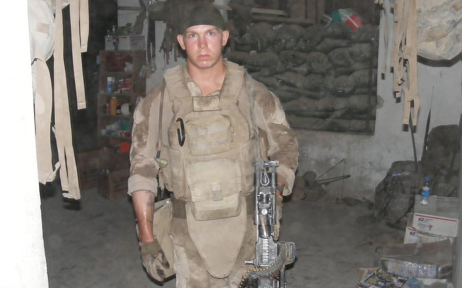 """Then-Marine Lance Cpl. James LaPorta in 2009 at Combat Outpost Sharp in Mianposteh, located on the outskirts of the Garmsir district of Afghanistan. He had recently returned from an hours-long firefight. LaPorta, now a staff writer at Newsweek, was hired by NBC as a military adviser for the television show """"This is Us."""""""