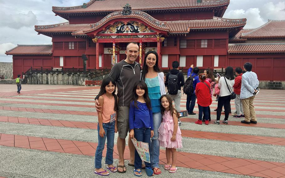 Marine Corps Maj. Indigo Gregory and his wife, Mari Gregory, pose with their daughters at Shuri Castle in Naha, Okinawa, in this undated photo.
