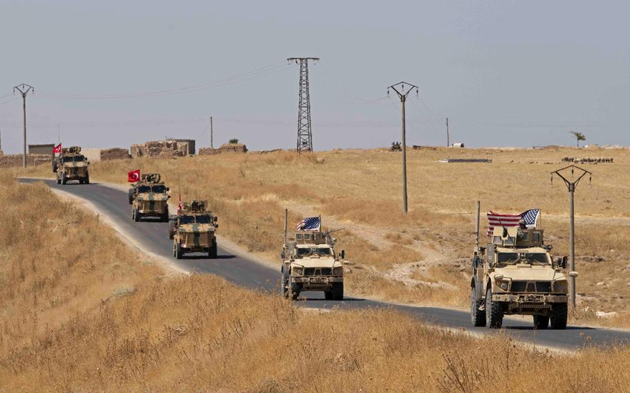 Turkish and U.S. military personnel conduct a joint patrol at the Syria-Turkey border in northeast Syria, Sept. 8, 2019.  Turkey remains a transit point for foreign fighters looking to join the Islamic State in Iraq and Syria, and could help the terrorist group to regroup and regain influence, a U.S. report on global terrorism released Friday, Nov. 1, 2019, says.