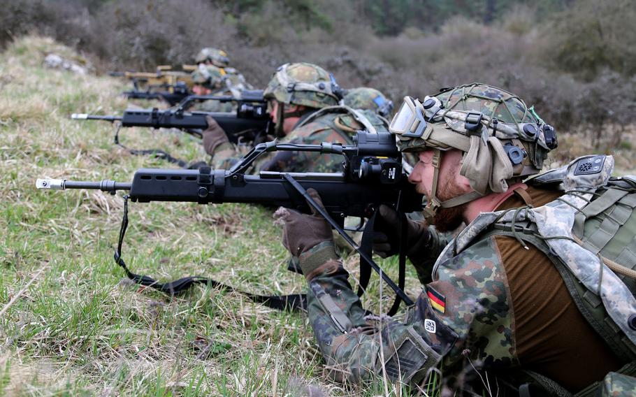 German soldiers provide suppressive fire during NATO exercise Allied Spirit X in Hohenfels, Germany, in April 2019. Germany will meet the NATO target of spending 2% of economic output on its military by 2031, Defense Minister Annegret Kramp-Karrenbauer said Thursday, Nov. 7, 2019.