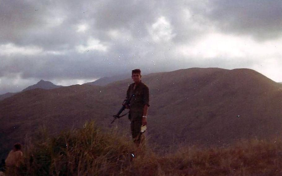 1st Lt. Michael McDonald-Low awaits the arrival of a helicopter on May 5, 1968, to take him and other soldiers to Hill 352, Nui Hoac Ridge, South Vietnam.