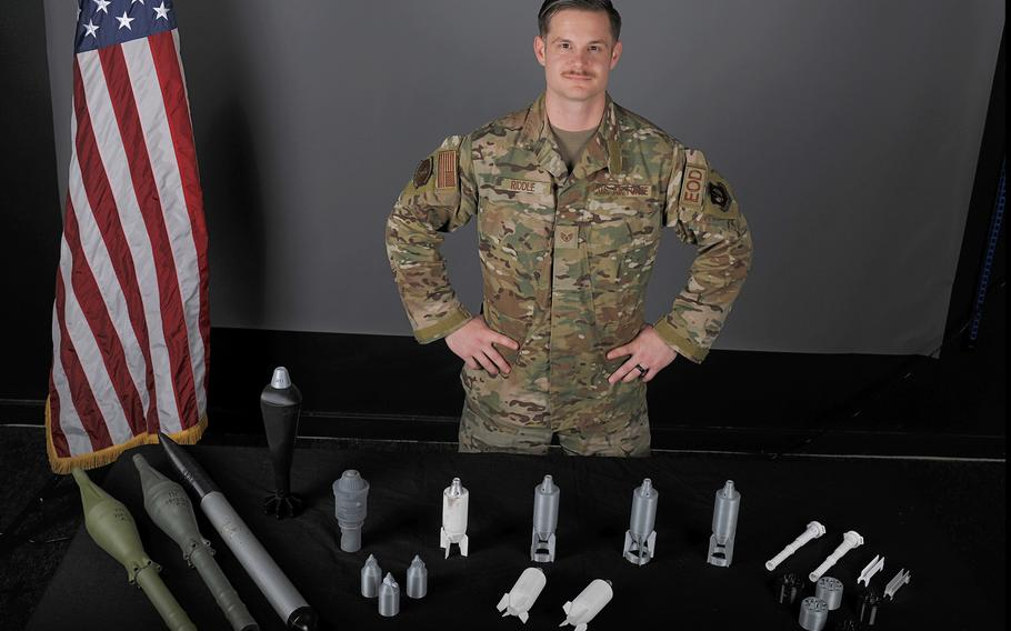 Staff Sgt. William Riddle, a 48th Civil Engineer Squadron Explosive Ordnance Disposal NCO, displays EOD training aids he printed from a 3D printer at RAF Lakenheath, England, Nov. 19, 2019. The 3D printer allows training aids to be produced for a fraction of the normal cost.