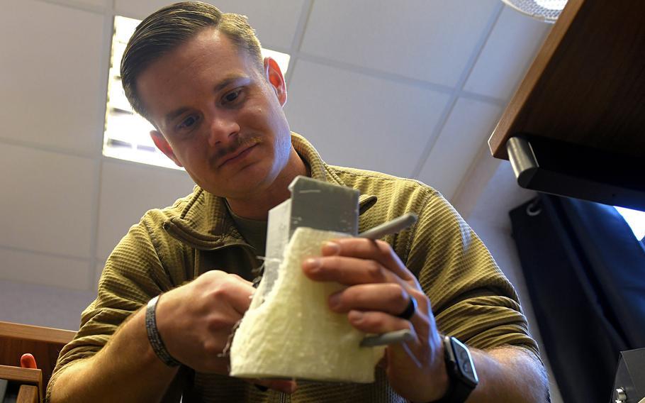Staff Sgt. William Riddle, a 48th Civil Engineer Squadron  Explosive Ordnance Disposal NCO, designs a model for a training aid at RAF Lakenheath, England, Nov. 19, 2019.