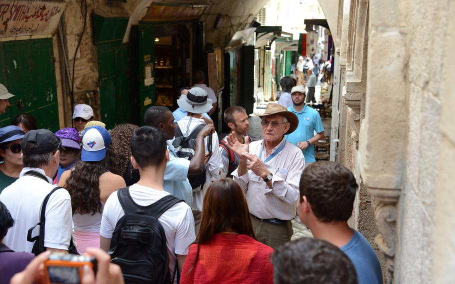 A tour group visits Jerusalem's Old City along the Via Dolorosa. U.S. European Command said Monday, Dec. 2, 2019,  it has lifted an order restricting travel there, but American military personnel are still prohibited from visiting other parts of the West Bank, including Bethlehem and Jericho.