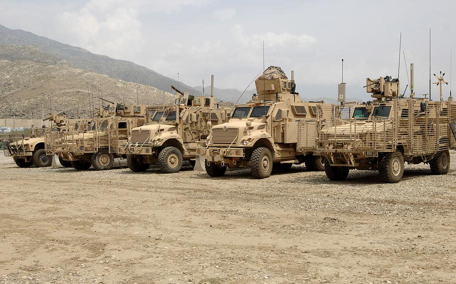 Mine Resistant Ambush Protected (MRAP) vehicles stand in a row before going out on a mission in eastern Afghanistan. A whistleblower case alleges that a defense contractor, Navistar, bilked the Pentagon out of more than $1 billion on a contract to build MRAP vehicles.