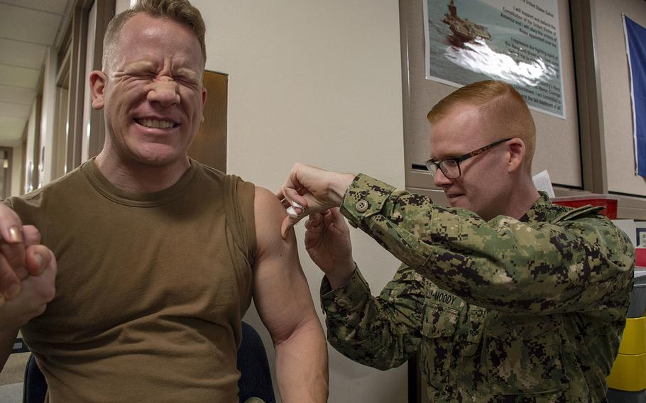 A sailor receives a flu vaccination at Naval Hospital Bremerton, Wash., Oct. 21, 2019, through coverage by Tricare.