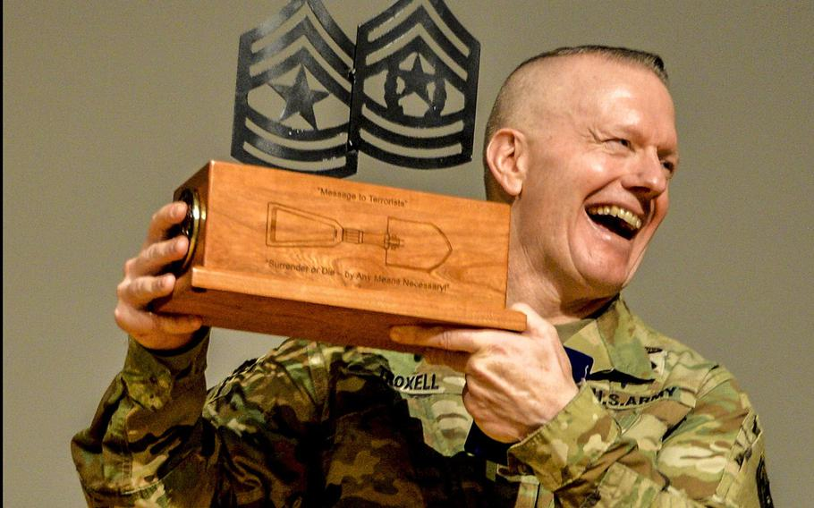 Command Sgt. Maj. John Wayne Troxell, senior enlisted adviser to the chairman of the Joint Chiefs of Staff, shows the memento presented to him during his last visit to the NCO Leadership Center of Excellence in El Paso, Texas, Nov. 21, 2019. Troxell retires Dec. 13, after nearly 38 years in the Army.