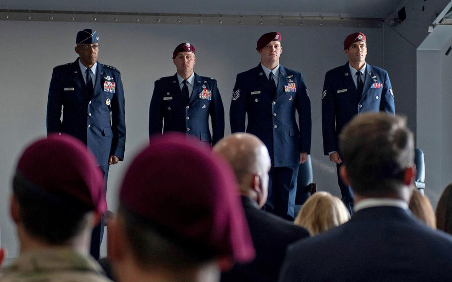 Left to right, Gen. Charles Q. Brown Jr. and Lt. Col. Douglas Holliday stand with pararescuemen Tech. Sgt. Gavin Fisher and Staff Sgt. Daniel Swensen during a Silver Star Medal  ceremony at Nellis Air Force Base, Nev., Dec. 13, 2019. Fisher and Swensen received the medals for gallantry in action while deployed to Afghanistan.