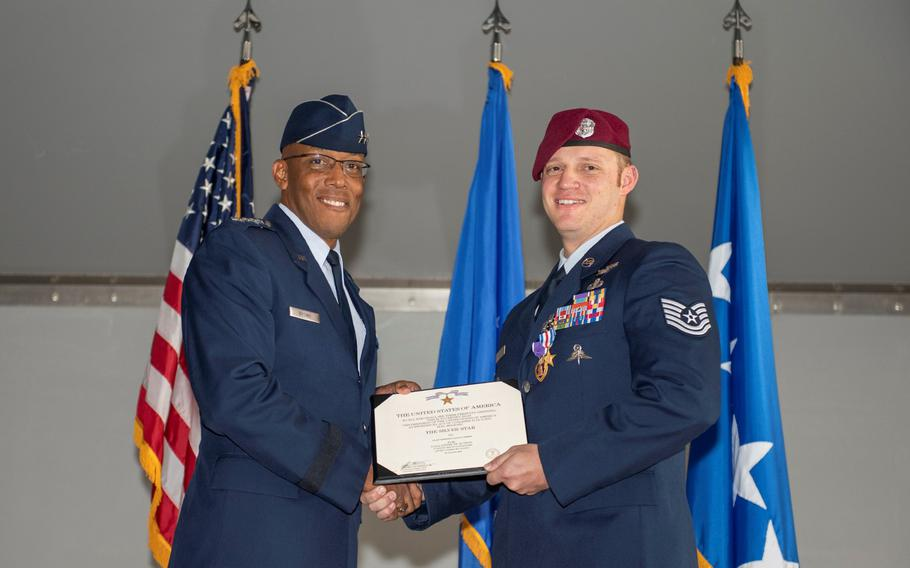 Gen. Charles Q. Brown Jr., Pacific Air Forces commander, presents the Silver Star Medal to Tech. Sgt. Gavin Fisher, 350th Special Warfare Training Squadron pararescueman, in a ceremony at Nellis Air Force Base, Nev., Dec. 13, 2019.