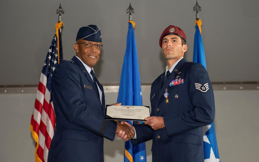 Gen. Charles Q. Brown Jr., Pacific Air Forces commander, presents the Silver Star Medal to Staff Sgt. Daniel Swensen, 58th Rescue Squadron pararescueman, in a ceremony at Nellis Air Force Base, Nev., Dec. 13, 2019.