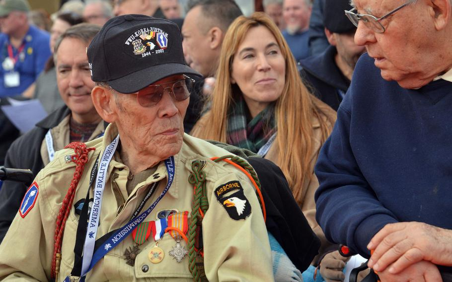Battle of the Bulge veteran Robert Izumi talks to an attendee of the commemorations at the Luxembourg American Cemetery marking the 75th anniversary of the Battle of the Bulge, Monday, Dec. 16, 2019. After the war Izumi enlisted in the Air Force and fought in the Korean and Vietnam wars.