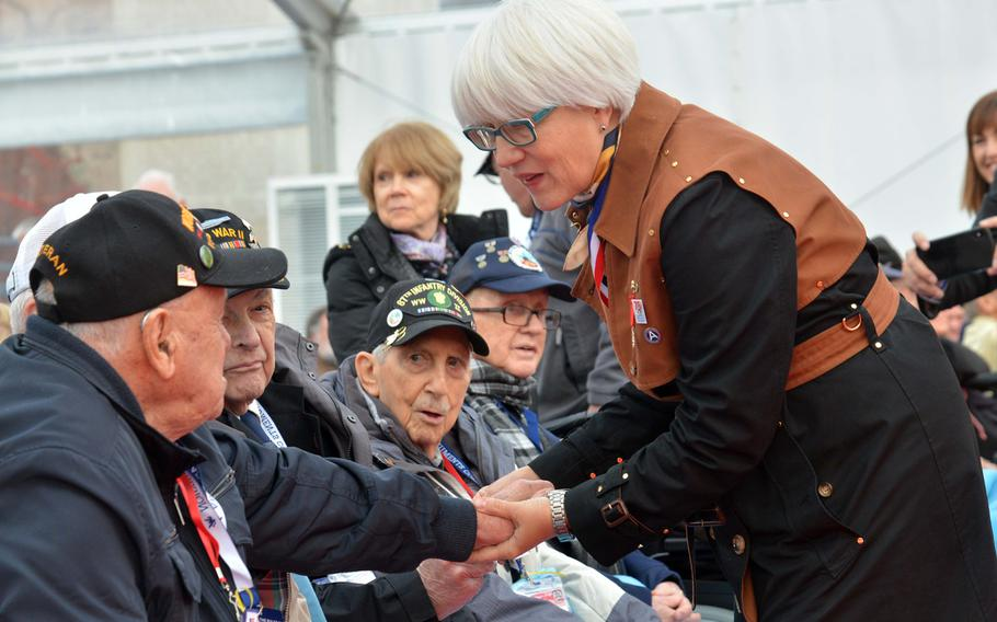 Helen Patton, granddaughter of Gen. George S. Patton, talks to Battle of the Bulge veterans before the commemorations at the Luxembourg American Cemetery marking the 75th anniversary of the battle, Monday, Dec. 16, 2019. The general is buried at the cemetery.
