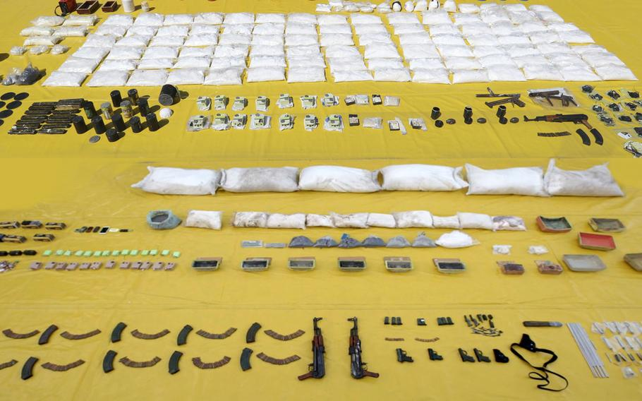 Arms seized from allegedly Iran-backed militants in Bahrain are shown here in a Bahraini government photo from March 3, 2018. The bomb components seized by Bahrain between 2013 and 2018 were similar to those found in weapons intended for Yemen in 2013, London-based Conflict Armament Research said in a report published on Tuesday, December 17, 2019.