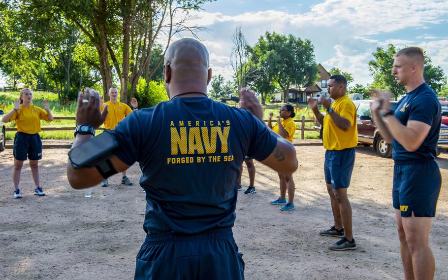 Reserve sailors at Navy Operational Support Center Fort Carson, Colo. warm up before a fun run in July 2019. Walmart must pay a Navy reservist back pay and review its hiring policies as part of a lawsuit settlement with the Department of Justice, after a store in Grand Junction, Colo., denied the reservist a seasonal, part-time job when she disclosed she would need to take two weeks off during the summer for reserves training.