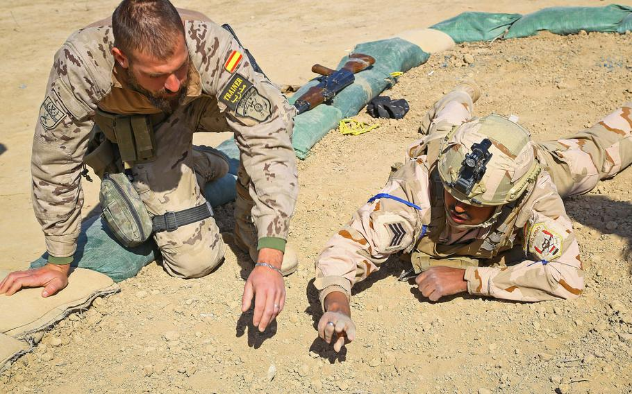 A Spanish trainer goes over techniques to detect improvised explosive devices with an Iraqi soldier at the Besmaya Range Complex, Iraq, in 2018. NATO Secretary-General Jens Stoltenberg responded to a request by President Donald Trump that European alliance members become more involved in the Middle East by saying on Jan. 9, 2020, that the alliance can do more in the volatile region.