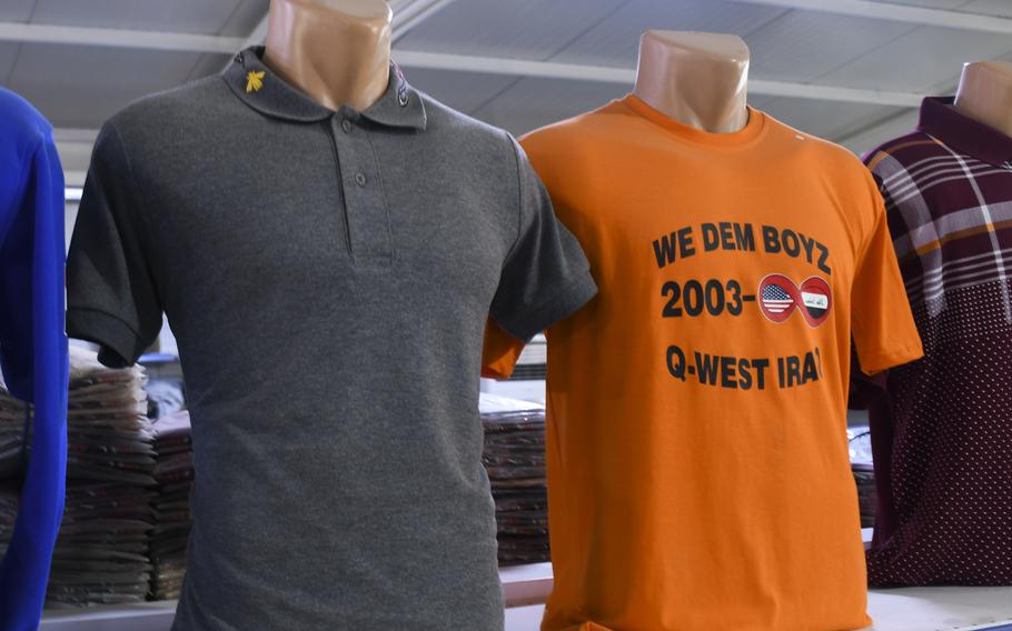 A T-shirt indicating a potential U.S. presence at Qayara Airfield West, also known as Q-West, from 2003 to infinity is displayed Thursday, Dec. 26, 2019, in a bazaar on the base about 40 miles south of Mosul, Iraq.