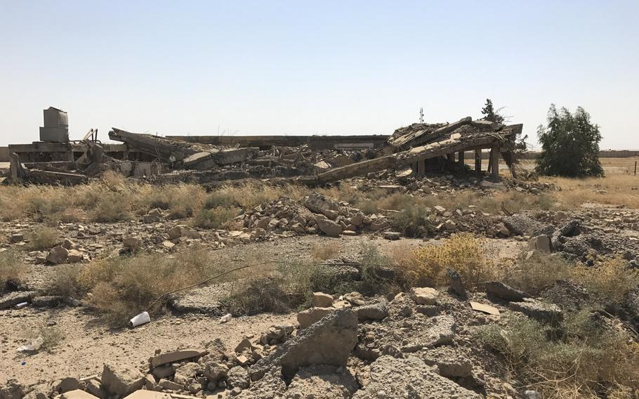 The rubble of a flattened building on Qayara Airfield West is seen Friday, Sept. 22, 2017. The base had been taken by Islamic State in 2014 and was destroyed by the militants and the fighting to retake the base from them. U.S. Army engineers rebuilt part of the base in late 2016 as part of the Iraqi military's coalition-backed push to retake Mosul.