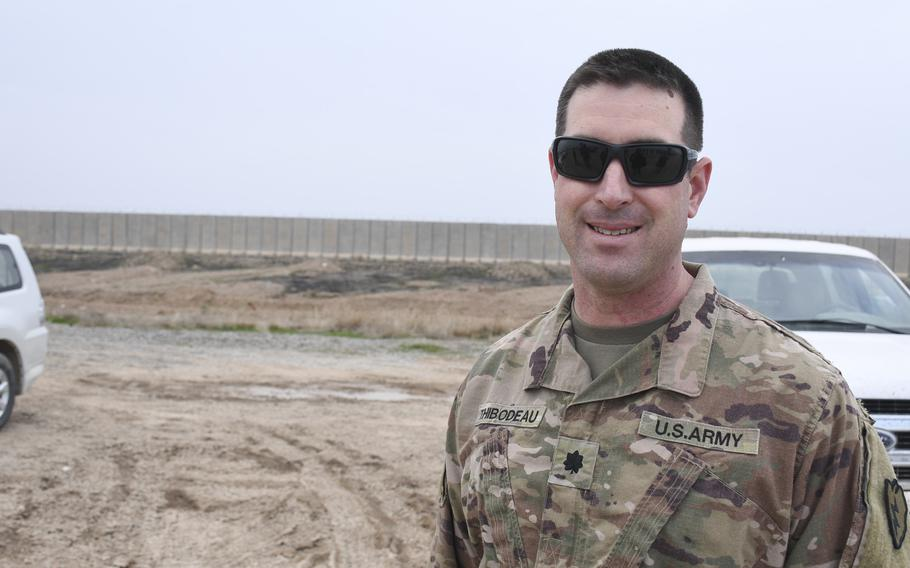 Lt. Col. Stephen Thibodeau, commander of 2nd Battalion, 8th Field Artillery Regiment, stands at the helicopter landing zone at Qayara Airfield West in Iraq, on Thursday, Dec. 26, 2019.