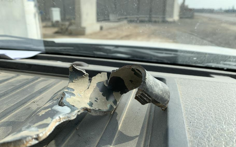 A fragment from a rocket that struck Qayara Airfield West in November is displayed on the dash of a U.S. government truck at the base on Thursday, Dec. 26, 2019.
