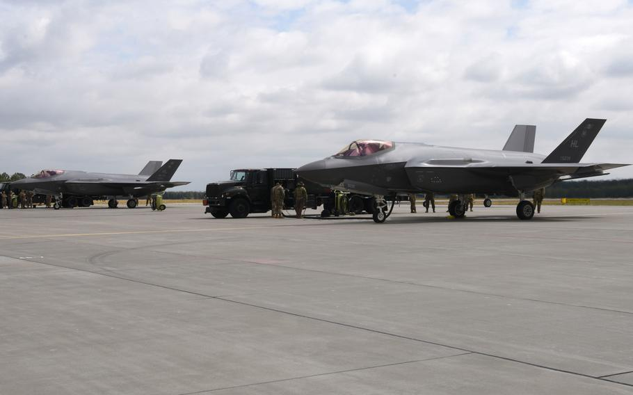 Two U.S. Air Force F-35A Lightning II aircraft sit on an apron during Operation Rapid Forge on Powidz Air Base, Poland, July, 16, 2019. Poland is scheduled to sign a contract for 32 F-35s, setting itself up to become the first country in Eastern Europe to fly the 5th-generation aircraft.
