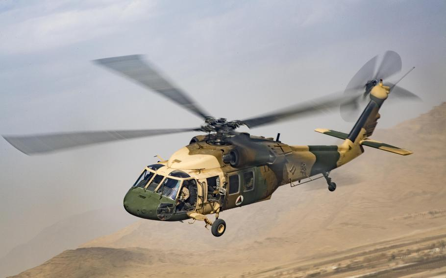An Afghan Air Force UH-60 Black Hawk flies during a NATO-led mission in Afghanistan in 2018. The U.S. is providing less money and fewer Black Hawks and advisers to the Afghan air force.