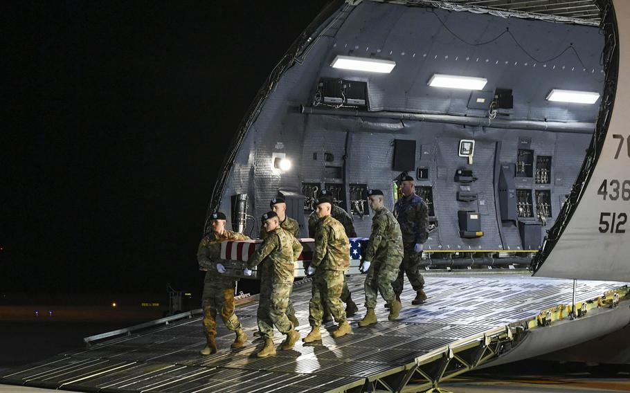 An Army carry team transfers the remains of Spc. Antonio Moore, Jan. 28, 2020 at Dover Air Force Base, Del. Moore died Jan. 24, 2020, in Syria during a vehicle rollover accident while conducting route clearance operations as part of Operation Inherent Resolve.